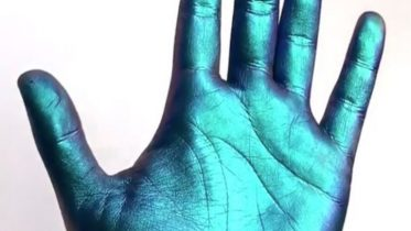 These Color-Changing, Full-Hand Swatches of Holographic Makeup Are Going Viral